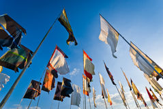 Flags at Glastonbury Festival. A wide angle shot of bright and colourful flags blowing in the wind at Glastonbury Festival, UK Stock Photos