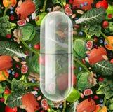 Pilule de nourriture de supplément Photos libres de droits