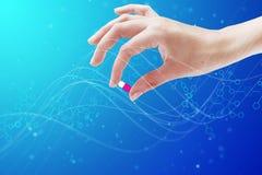 Pilule et main magiques Photos stock