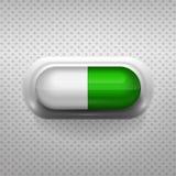 Pilule verte et blanche de capsule avec le fond Photos libres de droits