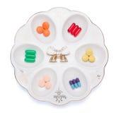 Pilules, capsules et comprimés du plat blanc Photo libre de droits