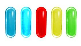 Pilules colorées d'isolement sur le fond blanc Image libre de droits