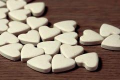 Pilules dans la forme de coeur Image libre de droits
