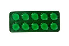 Pilules dans le habillage transparent d'isolement sur le fond blanc image stock