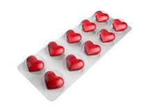 Pilules de coeur dans la boursouflure Photographie stock libre de droits
