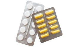 Pilules de médecine emballées dans des boursouflures d'isolement Photo stock
