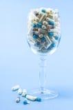 Pilules en verre de vin Image libre de droits