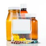 Pilules et récipient de drogue photos stock