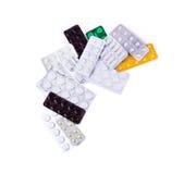Pilules multicolores de médecine sur le fond blanc Photos libres de droits