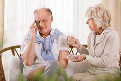Pilules pour le mal de tête Photos libres de droits