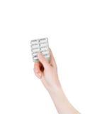 Pilules sur des mains Fond de médecine Photographie stock libre de droits