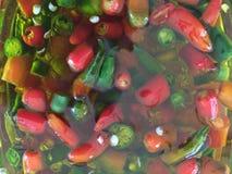 Pimentões orgânicos em Olive Oil Fotos de Stock Royalty Free