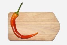 Pimentões, pimenta vermelha na placa de madeira Imagens de Stock