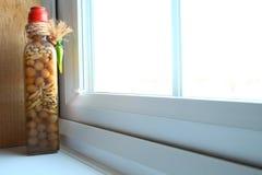 Piment dans la bouteille Photographie stock libre de droits