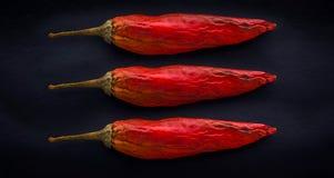 Pimenta de pimentão vermelho em um pano de saco Fotos de Stock Royalty Free