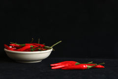 Pimenta em um fundo preto Foto de Stock