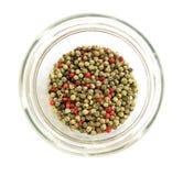 Pimenta multicolor no prato de vidro Foto de Stock Royalty Free