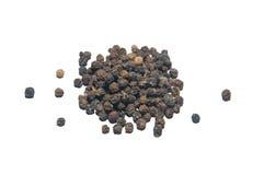 Pimenta preta no fundo branco Imagens de Stock