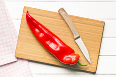 Pimenta vermelha na mesa de cozinha Foto de Stock Royalty Free