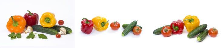 Pimentas amarelas e alaranjadas vermelhas com tomates em um fundo branco imagem de stock royalty free