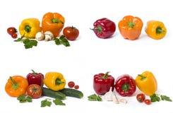 Pimentas amarelas e alaranjadas vermelhas com tomates em um fundo branco foto de stock