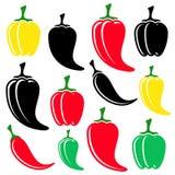 Pimentas coloridas e pretas Imagens de Stock