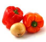 Pimentas com cebola Imagens de Stock