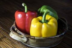 Pimentas de Bell em um prato Fotos de Stock