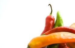 Pimentas de pimentão no branco Imagens de Stock Royalty Free