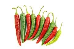 Pimentas de pimentão quente vermelhas & verdes Fotografia de Stock Royalty Free