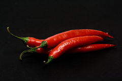 Pimentas de pimentões vermelhos Fotografia de Stock Royalty Free