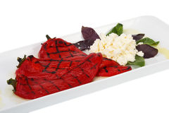 Pimentas de sino vermelhas com queijo Imagem de Stock