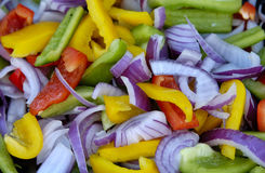 Pimentas e cebolas Foto de Stock
