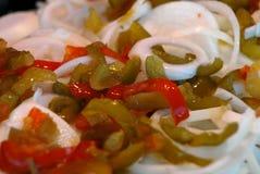 Pimentas e cebolas   Fotos de Stock