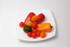 Pimentas e cereja dos tomates Foto de Stock