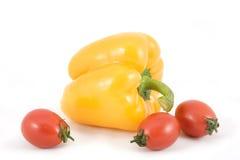Pimentas e tomates amarelos doces Imagens de Stock