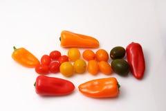 Pimentas e tomates de cereja Foto de Stock