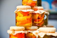 Pimentas em uns frascos fotografia de stock