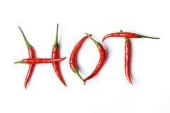 Pimentas encarnados nas letras Fotografia de Stock Royalty Free