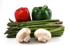 Pimentas, espargos e cogumelos Imagens de Stock