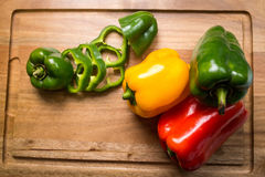 Pimentas na tabela Imagens de Stock