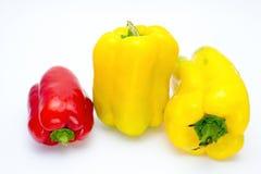 Pimentas no branco Imagens de Stock