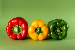 Pimentas no fundo verde Fotos de Stock Royalty Free