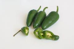 Pimentas quentes no fundo branco Fotos de Stock Royalty Free