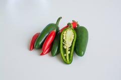 Pimentas quentes no fundo branco Imagens de Stock Royalty Free
