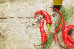 Pimentas vermelhas com especiaria Imagem de Stock Royalty Free