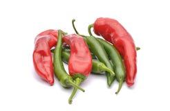 Pimentas vermelhas e pimentas de pimentão Imagem de Stock