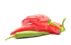 Pimentas vermelhas e pimentas de pimentão Fotos de Stock Royalty Free