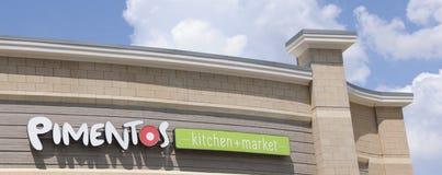 Pimentos Kitchen and Market Sign Royalty Free Stock Photos