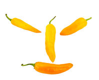 Pimienta de chile anaranjada de la sonrisa aislada en blanco Imagen de archivo
